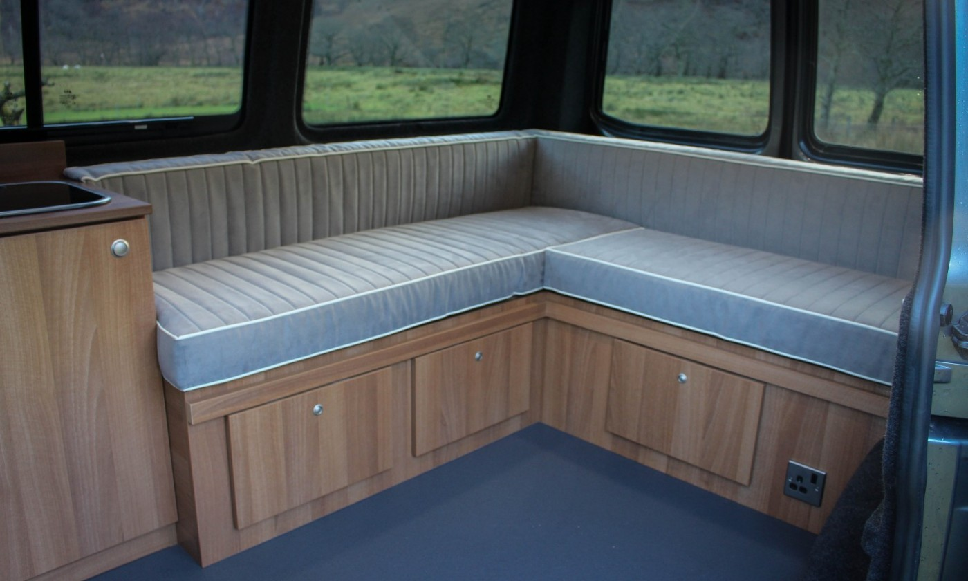 VW T5 Campervan Conversion Comfortline fitted with bespoke full width pull out bed and under cupboard storage also installed 240 hook-up and 2 burner hob